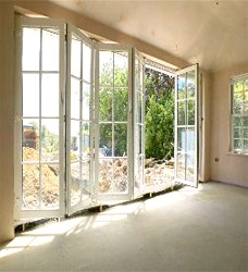 Patio doors installation for sale toronto mississauga buy the crewmembers will have to make some adjustments to the wooden frame of the house around the old window and new door to accommodate the patio doors planetlyrics Choice Image